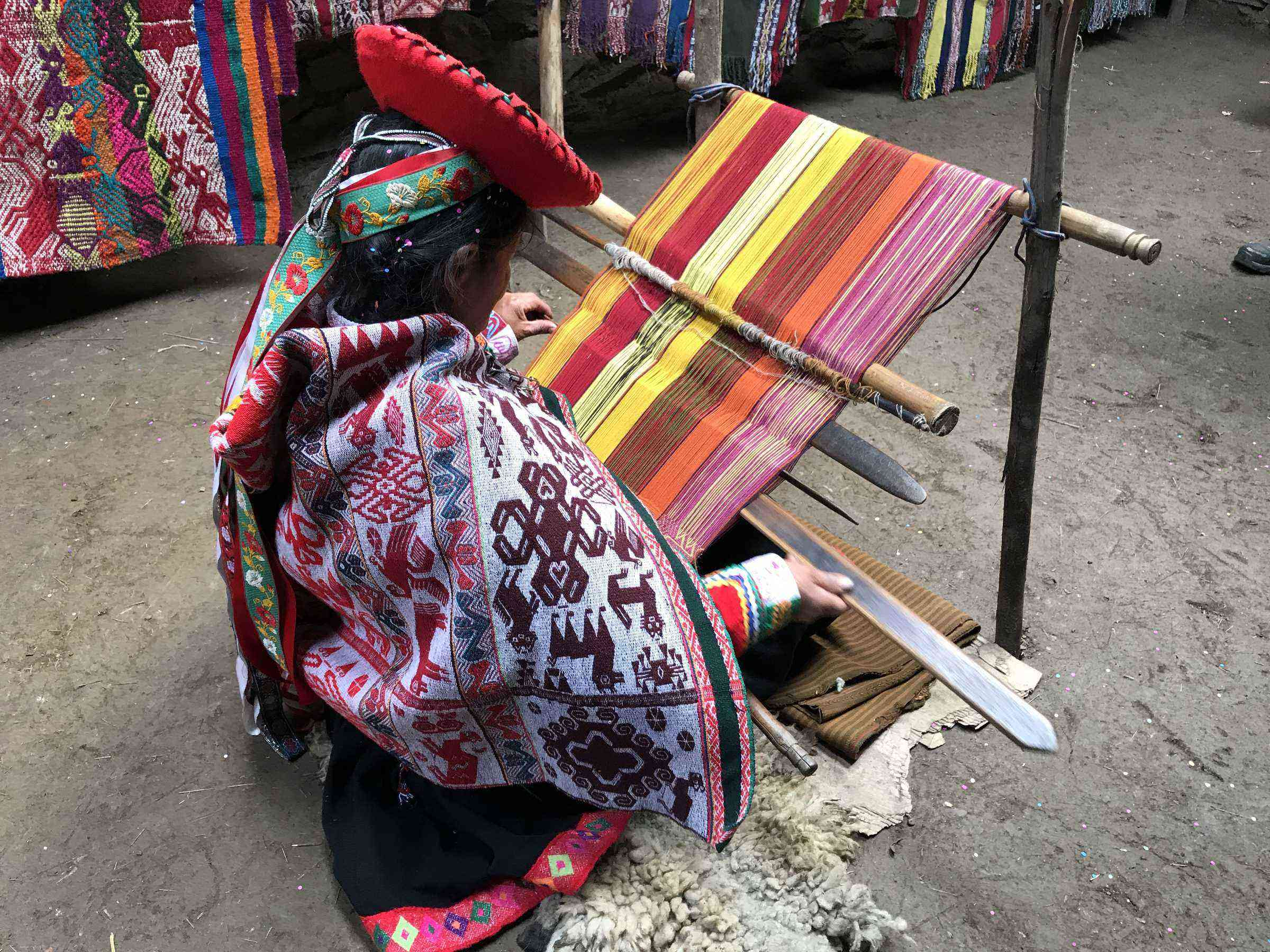 Struggling with Weaving, Ende Women Keep Cultural Preserve
